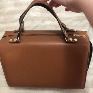 Brown bag with constellation interior New